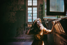 Girl In Old Derelict Building With Sunlight Streaming In