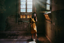 Girl In Derelict Building With Beautiful Light