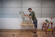 A Craftsman Restoring An Antiq...