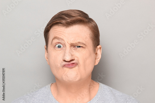 Fototapeta Portrait of funny man grimacing and making goofy crazy face