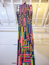 Artist Installs Large Colorful Tapestry Off A Scissor Lift.