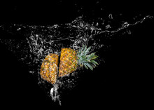 Pineapple Falling Into Water W...