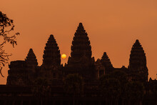 Angkor Wat, Siem Reap, Cambodia. Sunrise From Reflection Pool Showing 5 Towers Of Main Temple.