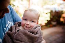 Holding Holding Nephew Wrapped...
