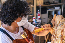 Craftswoman With Mask Carving ...