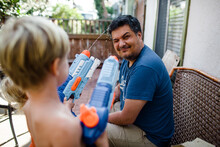 Nephews Shooting Water Guns At...