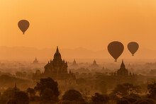 Bagan, Myanmar - 7 February 2014: Ballons Flying Over Temples Of Bagan At Sunrise.