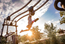 Young Girl Swings Her Legs On ...