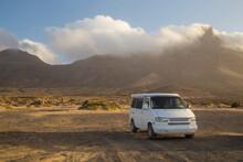 Camper Van Parked On Cofete Beach In Fuerteventura.
