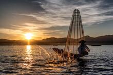 Inle Lake, Myanmar - 3 December 2017 Fisherman Slapping Water To Scare Fish Into His Prelaid Net.