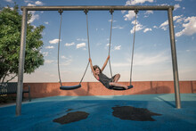 Young Girl Plays On A Swing Ho...