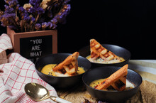 Waffle Dips In Soup Serving By The Slogan You Are What You Eat
