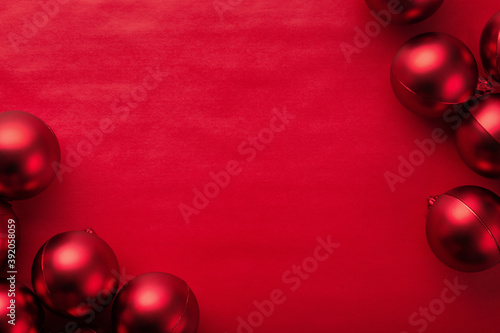 Christmas and new year with red balls on red background top view with copy space Fotobehang