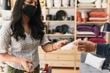 Woman Wearing Mask And Paying ...