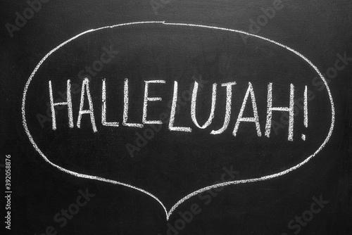 Fotografering hallelujah concept word on a blackboard background