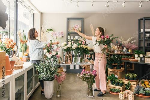 Master and apprentice florist in a flower workshop together