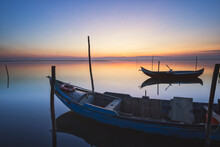 Wooden Boats At Sunset With Th...