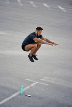 An Athletic Man Is Making Jumps In His Training