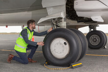 Male Mechanic Checking Aircraf...