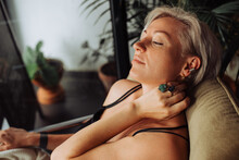 Blond Woman Resting While Sitting In Sofa In A Relaxed Position
