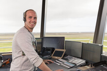 Cheerful Flight Operations Officer During Work