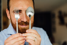 Close Up Portraits Of Man With Moustache Holding Fork And Spoon