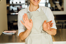 Midsection Of Female Chef In A...