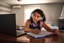 A Brunette Girl Writing In A N...