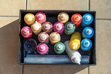 Many Painting Pots In Several Color In A Black Box On The Floor. Overhead Horizontal Photo