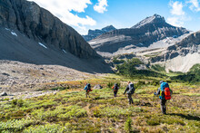 Group Of Trekkers Descend Into Remote Alpine Valley Near Banff