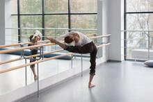 Female Ballet Dancer Stretchin...