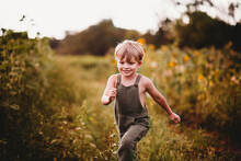 Smiling Boy Running In A Field...