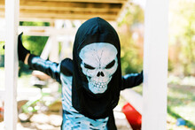 Little Boy Wearing A Skeleton Halloween Costume