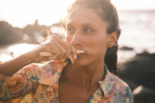 Portrait Of Beautiful Woman Brushing Her Teeth With Bamboo Toothbrush