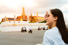 Young Woman Traveling To Grand Palace And Wat Phra Keaw At Sunse