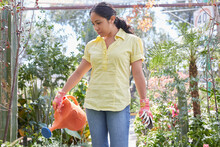 Latin Woman Doing Garden Work