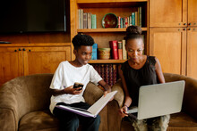 Homeschooling Session With Black Mom And Preteen Son