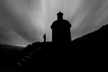 Silhouette Of Lighthouse And M...