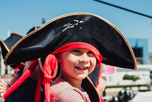Close Up Portrait Of 6 Year Multi Racial Boy In Black Pirate Hat
