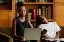 Exasperated Black Mother With Computer Tutoring Tired Preteen Son