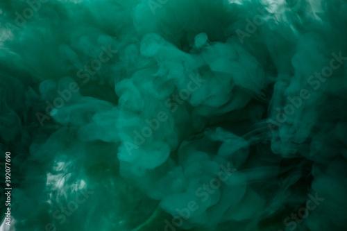Obraz Green smoke bomb exploding against white background - fototapety do salonu