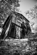 Damaged And Abandoned Old Wood Building In Black And White Artistic Edit