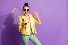 Photo Of Young Happy Cheerful Positive Beautiful Girl Woman Female Hold Badminton Rocket Showing V-sign Isolated On Purple Color Background