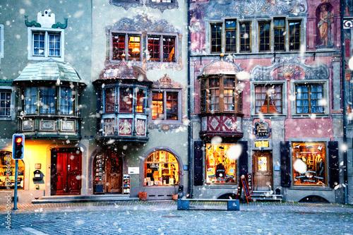 snowing in picturesque swiss village Stein am Rhein at night Fototapete