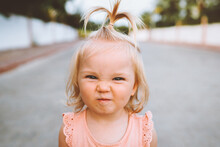 Child Girl Smiling Face Portrait Cute Baby 1 Year Old Candid Emotions Blond Hair Funny Kid Looking At Camera Close Up Outside