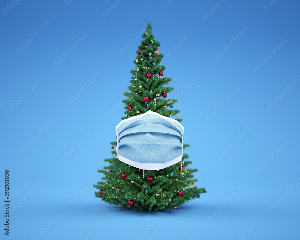 Fototapeta Christmas tree protected with a surgical mask. Blue background.