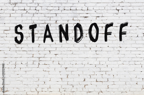 Inscription standoff painted on white brick wall Wallpaper Mural