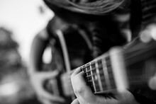 Fingers On The Strings, Girl Playing Acoustic Guitar. Black And White Photo.