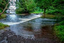 Swollen Stream Over Road