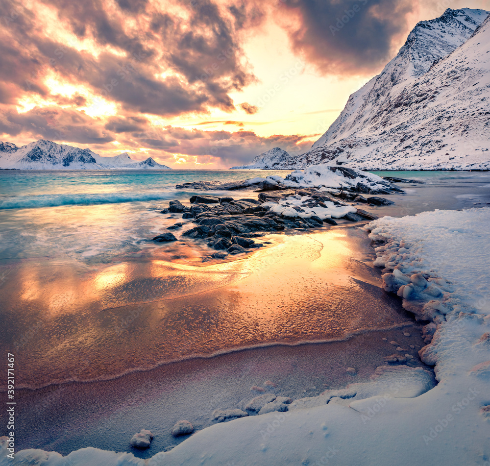 Fototapeta Colorful winter sunset on Lofoten Islands, Norway, Europe. Breathtaking morning scene of popular tourist destination - Skagsanden beach, Flakstadoya island. Untouched Winter Landscape.